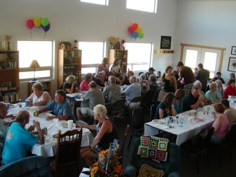 People seated and eating at a catered event.