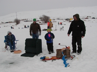 Families fishing at NW Ice Fishing Festival on Sidley Lake.
